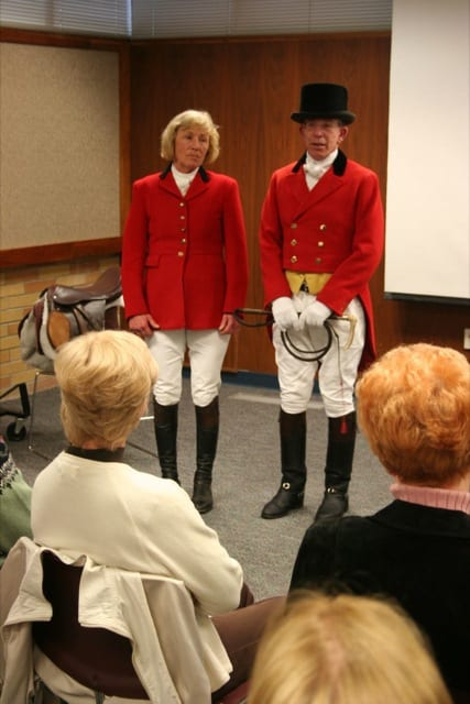HUNT CLUB MEMBERS IN FULL DRESS - Jean Brooks and Mike Wager show off the customary outfits worn by participants in a fox hunt at the Woodbrook Hunt Club. They explained the parts of their outfits before author Joy Keniston-Longrie spoke about the club before members of the Lakewood Historical Society.